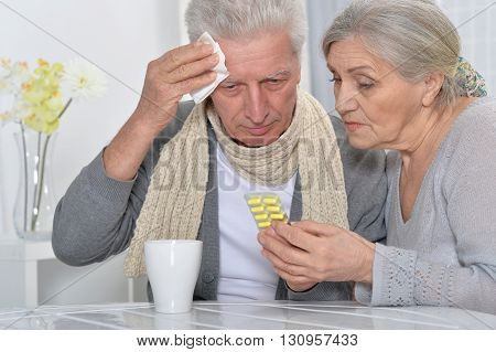 Portrait of a ill senior man and caring wife