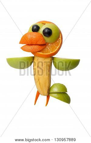 Funny crow made of juicy fruits on white background