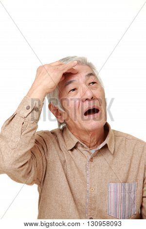 portrait of senior Japanese man has lost his memory on white background