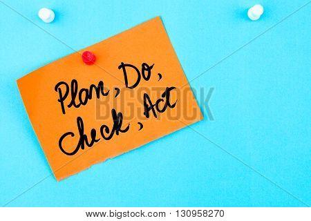 Plan, Do, Check, Act Written On Orange Paper Note