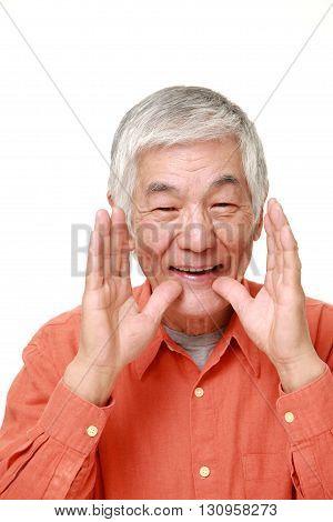portrait of senior Japanese man shout something on white background