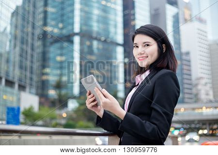 Businesswoman hold with a tablet