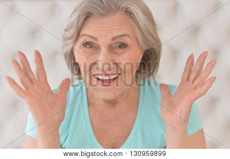 Portrait of a surprised senior woman close up