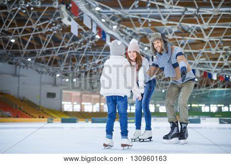Family at ice-skating rink