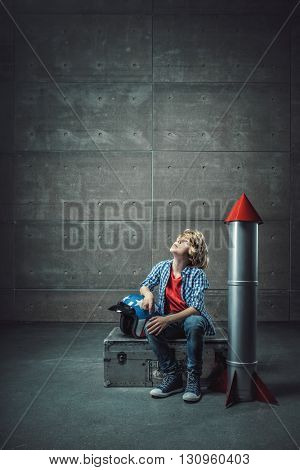 Boy with a rocket in studio