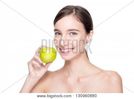 Smiling beautiful woman holding green apple