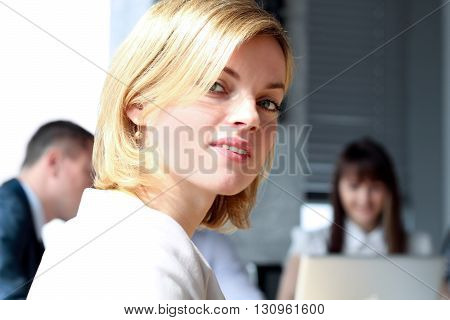 Beautiful bisness woman. business colleagues analyzing financial figures on a laptop