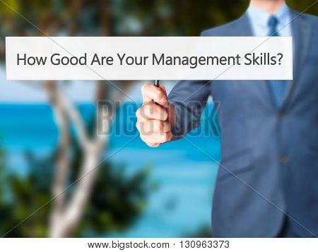 How Good Are Your Management Skills - Businessman Hand Holding Sign