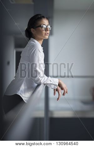 Strong confident business woman standing in an office building