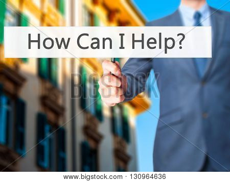 How Can I Help ? - Businessman Hand Holding Sign