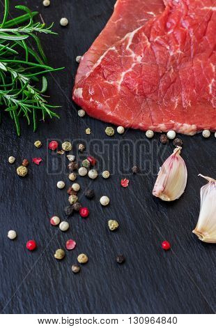 Fresh raw beef from the farmers market on a black grunge table. Selective focus, flat lay