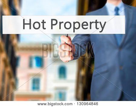 Hot Property - Businessman Hand Holding Sign