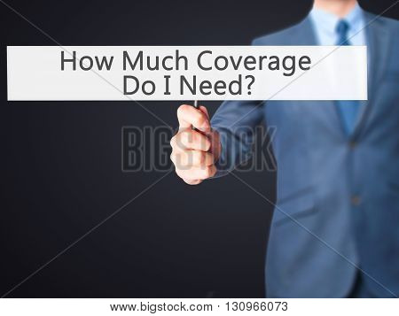 How Much Coverage Do I Need - Businessman Hand Holding Sign