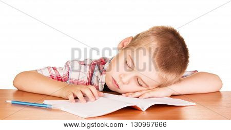 Boy asleep at his desk on a notebook isolated on white background.