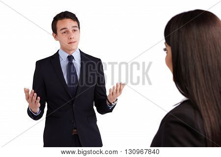 Young Caucasian Business Man Looking Doubtful At A Business Woman
