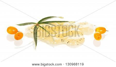 Natural facial scrub of sea buckthorn berries isolated on a white background.