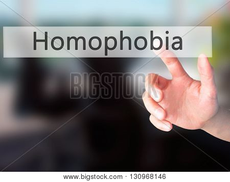 Homophobia  - Hand Pressing A Button On Blurred Background Concept On Visual Screen.