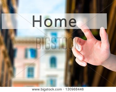 Home - Hand Pressing A Button On Blurred Background Concept On Visual Screen.