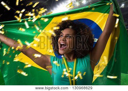 Brazilian woman fan holding the Brazilian flag in the stadium