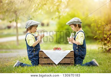 Two Beautiful Children, Boy Brothers, Eating Strawberries And Cookies