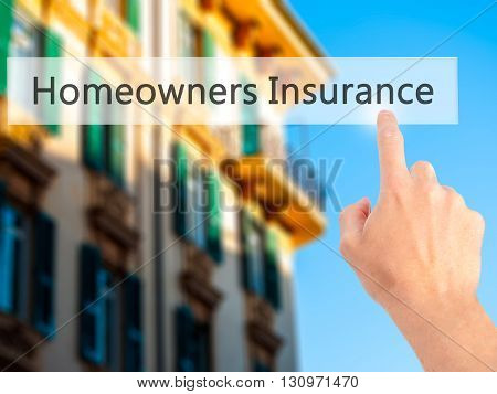 Homeowners Insurance  - Hand Pressing A Button On Blurred Background Concept On Visual Screen.