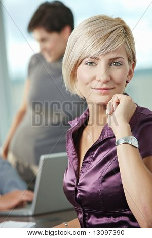 Smiling attaractive businesswoman at office