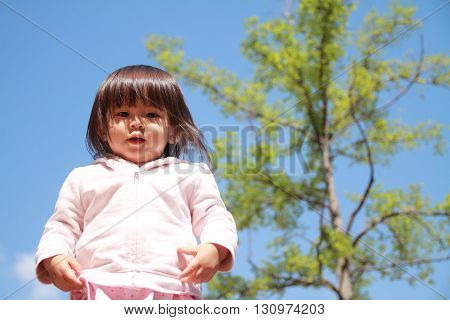 Smiling Japanese girl under the blue sky (1 year old)