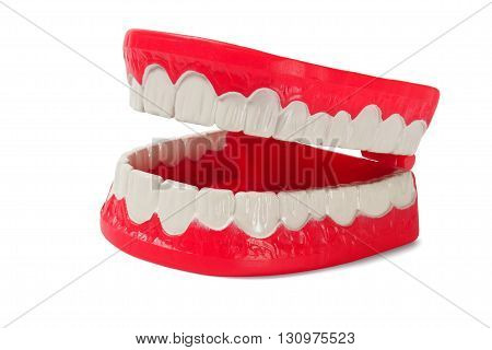 Open plastic denture (toy) on white background