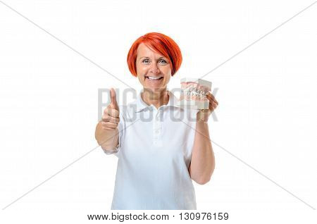Woman Holding Toothbrush And Thumb Up