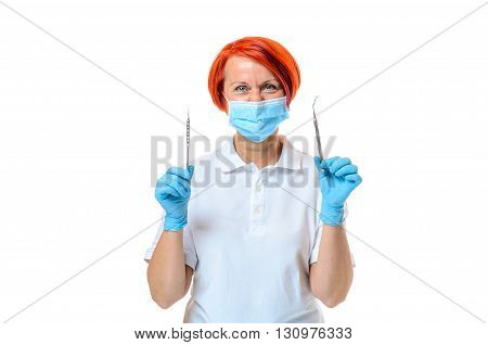 Health Care Professional Holds Dental Instruments