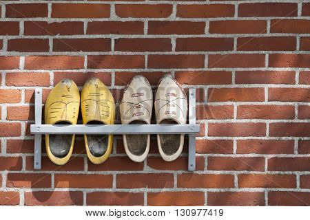 Wooden shoes hanging outdoor on a wall