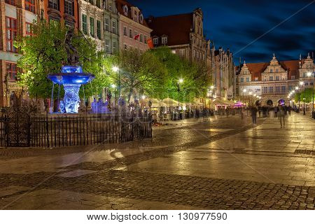 GDANSK, POLAND - MAY 05, 2016: Street scene with some people on Long Street in Old Town at night in Gdansk. Old Town in Gdansk is a tourist attraction for visitors.