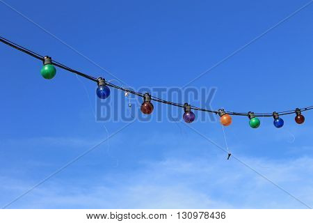 Fish hooks caught in string of lights