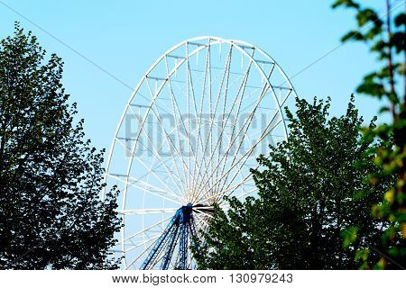 Abstract Background, part of a design of a ferris metal-wheel against sky.