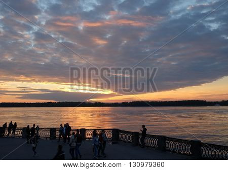 Samara RUSSIA - May 22 2016: People walk on the waterfront at sunset. Volga River.