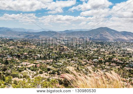 View of mountains and city from Mt. Helix Park in La Mesa, a city in San Diego, California.