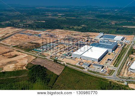 Industrial estate land development, construction aerial view
