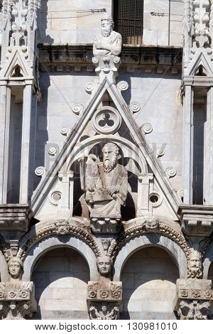 PISA, ITALY - JUNE 06, 2015: Saint John the Evangelist, Baptistery decoration architrave arches, Cathedral in Pisa, Italy. Unesco World Heritage Site, on June 06, 2015