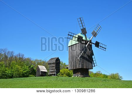 Rural Landscape With Old Wooden Windmills