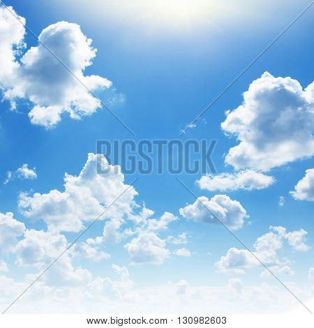 Blue sky with white clouds and sun.