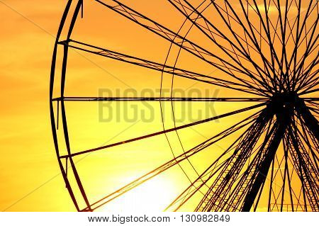 Abstract Background, part of a design of a ferris metal-wheel against sky with sunset.