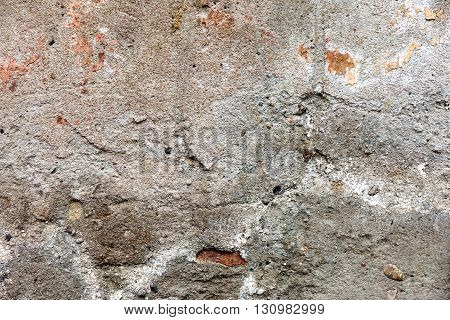 Grunge cracked concrete wall. Destroyed gray surface.