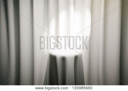 White magician's table with limelight and curtains in the background. Mock up 3D Rendering