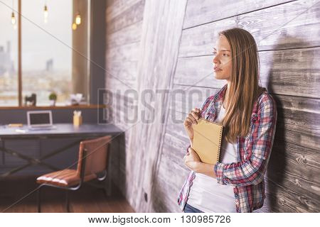 Young Woman With Notepad