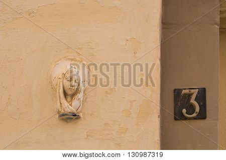 Most of the residential houses at the mediterranean island Malta have on the walls close to the entrance a portrait of the saint for the protection.