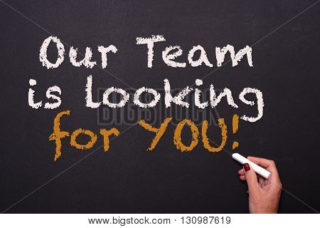 woman is writing on blackboard - our team is looking for you