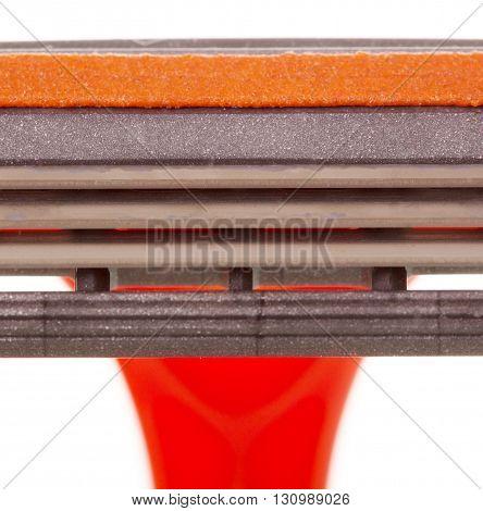 Orange razor close up isolated on white background.