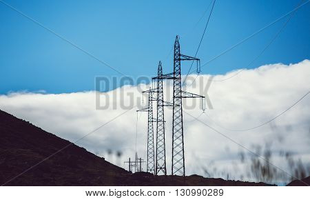high voltage power lines in mountains nature