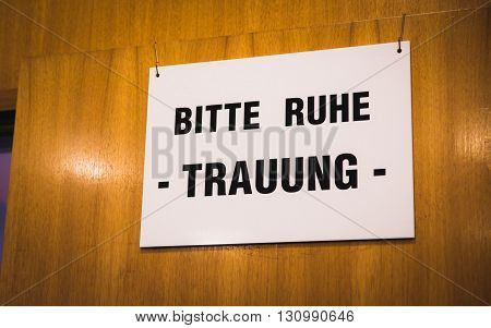 german wedding sign to be quiet at registry office
