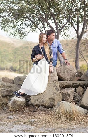Beautiful happy smiling couple embracing outdoors together
